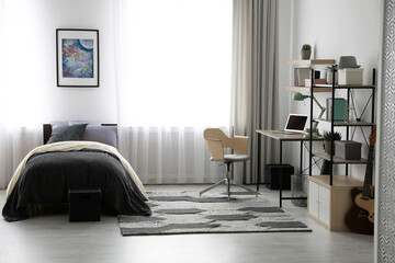 Modern teenager's room interior with workplace and bed