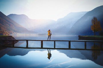girl stands on a wooden bridge