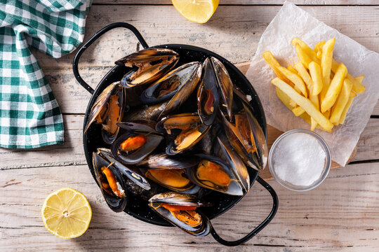 Moussels and french fries or molues-frites. Typical Belgian food. Top view