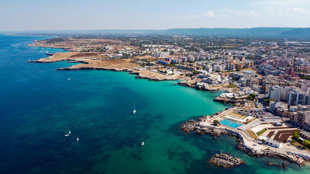 Aerial view of Monopoli in Apulia, south of Italy - Irregular coast with sandstone cliffs and blue waters along the Adriatic Sea