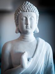 white sculpture of buddha, god of buddhism