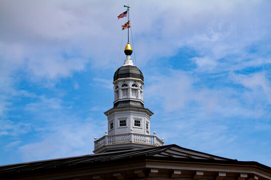 Bug eye view of Maryland State house (State Capitol) building in Annapolis. image features the iconic tower with Maryland  and US flags. Building has  a dome with windows and decorative bricks on.