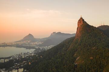 Aerial View Of Christ The Redeemer Statue Atop Corcovado Mountain And Rodrigo De Freitas Lagoon During Golden Hour, Rio De Janeiro, Brazil