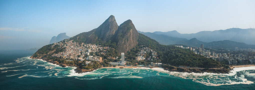 Aerial Panoramic View Of Two Brothers Mountain And Vidigal Favela With Tropical Ocean Waves Breaking Along The Coastline In Rio De Janeiro, Brazil