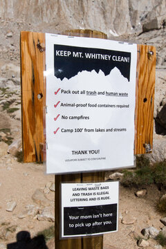 Your Mom Isn't Here - A sign on the Mount Whitney trail reminds hikers of proper trail behavior. Inyo National Forest, Lone Pine, California, USA