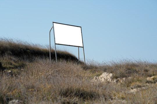 real billboard in nature on an island in the mediterranean sea.