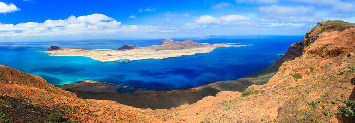 Scenery of volcanic Lanzarote - panoramic view from Mirador del Rio for island Graciosa. Canary islands