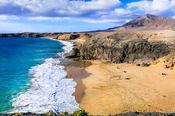Scenic nature and beautiful colorful beaches of volcanic Lanzarote. Papagayo beach. Canary islands