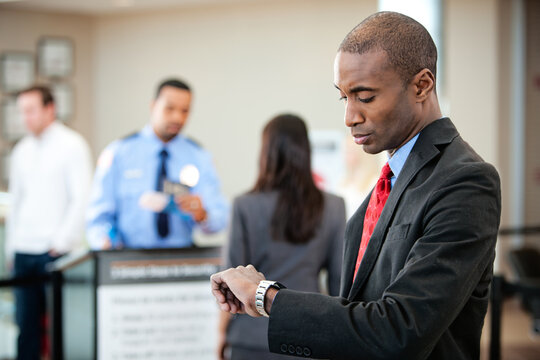 Airport: Impatient Traveler Checks Watch Near Security