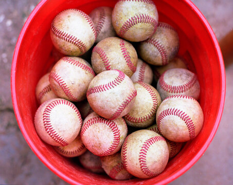 Bucket of baseballs shot on portra medium format film.