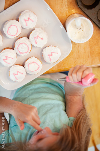 Mother's Day: Girl Licks Icing From Fingers