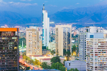 South America, Chile, Santiago city skyline and the Andes mountains at dusk