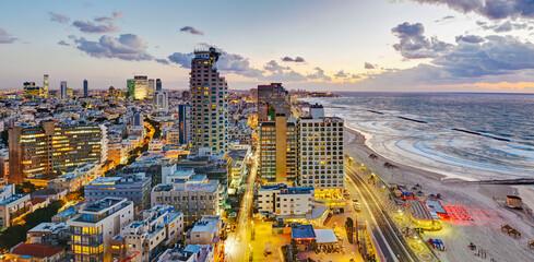 Middle East, Israel, Tel Aviv, elevated dusk view of beachfront hotels and coastline