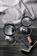 Wine: Two glasses of red wine and corkscrew