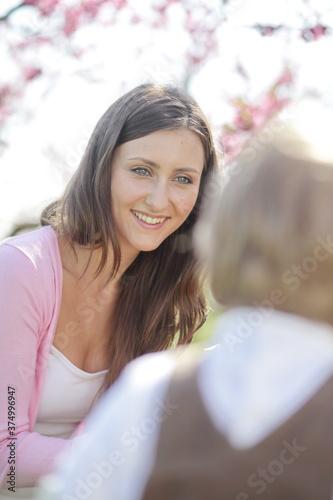 beautiful woman outdoors listening