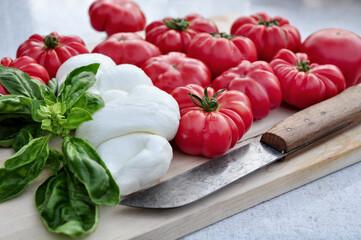 Food: Bulls heart tomatos, mozzarella cheese and basil