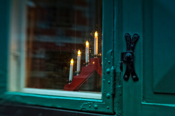 Christmas lights on a window sill in Sweden