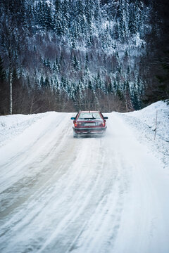 Car driving on the road with snow during winter