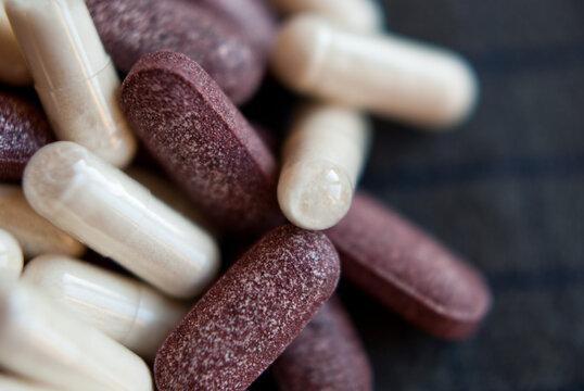 white and redish pills