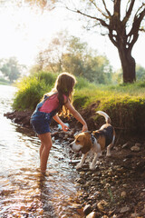 Girl and her pet refresh in river.