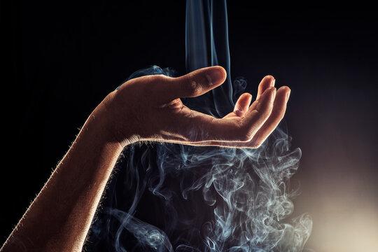 Smoke Falling Through Hand