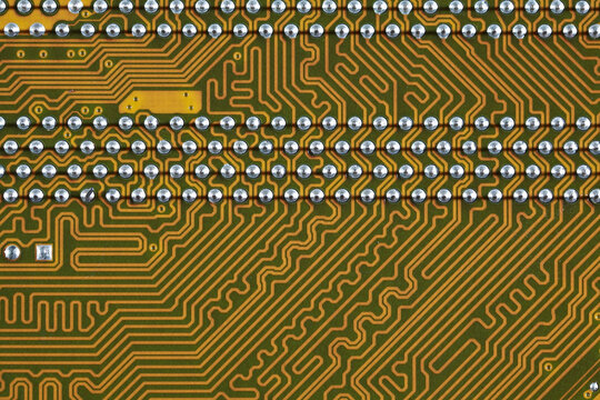 Gold circuit board background of computer motherboard