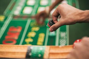 Casino: Man Placing Bet In Game Of Craps