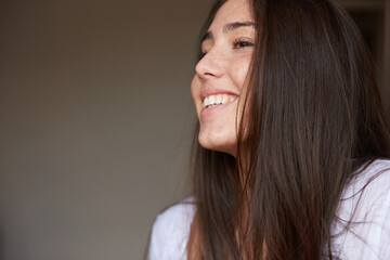 Close-up of attractive young woman smiling
