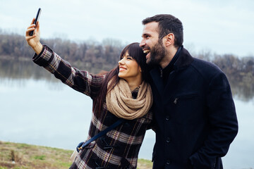Couple Taking Selfies in Nature on a Winter Day