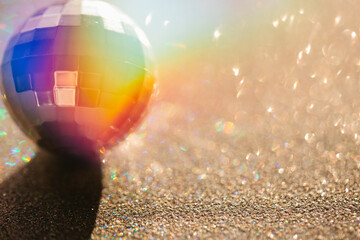 Double exposure disco ball with colorful light