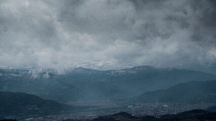 Dramatic Sky Over the Town and the Mountains