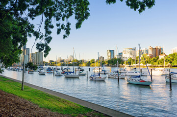 Brisbane River with boats moored in the foreground, looking to the city and Storey Bridge