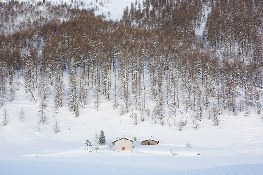 Two houses submerged by snow in the mountains