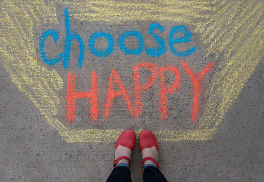 Feet standing above a positive message that says Choose Happy