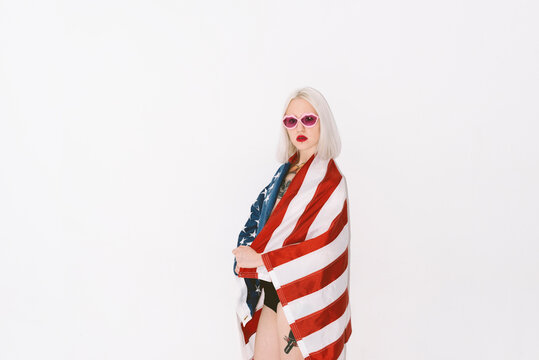 young blond woman with usa flag on the white background