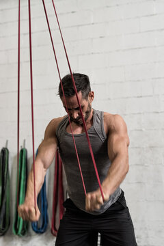Man working out with resistance bands in gym