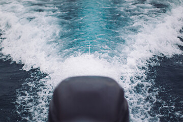 waves from a passing boat