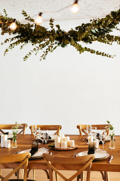 Twig garland over wooden banquet table