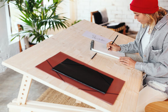 Focused designer creating sketches on table