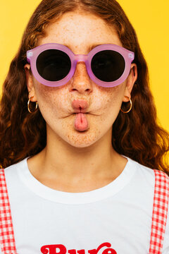 Redhead teen girl making fish face with lips