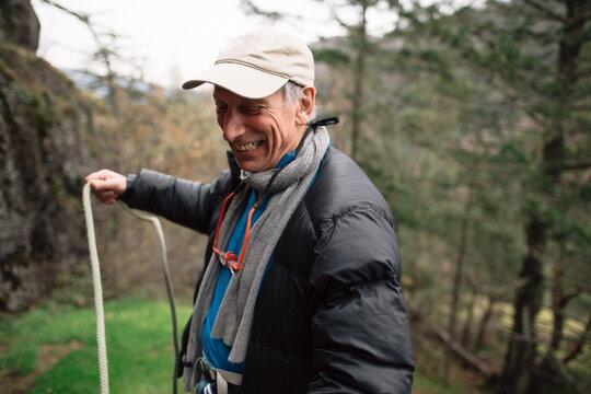 Active, mature rock climber enjoying his sport and lifestyle.