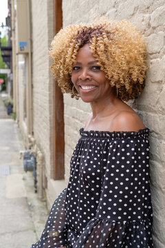 Middle-aged black woman in the city.