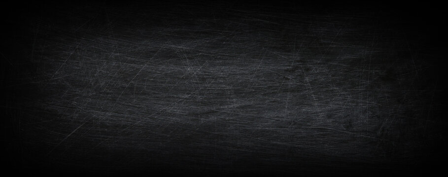 Dark, grunge and scratched chalkboard texture with empty space for text