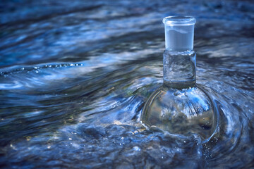 Glass flask with clear water.