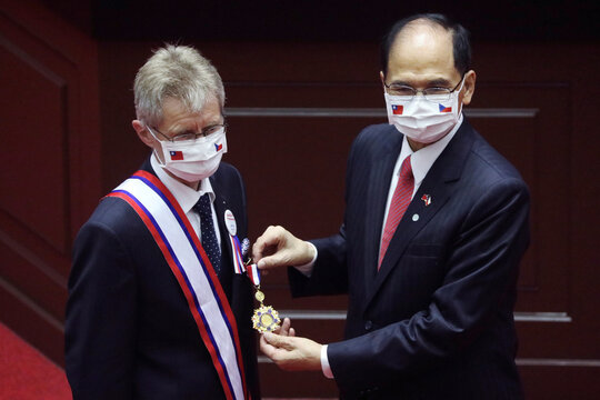 Czech senate president Milos Vystrcil receives a medal before delivering a speech at the main chamber of the Legislative Yuan in Taipei