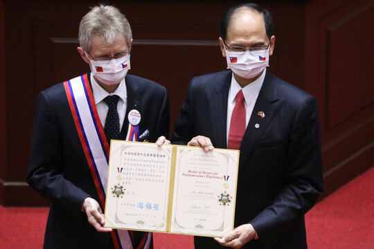 Czech senate president Milos Vystrcil receives a certificate for an award before delivering a speech at the main chamber of the Legislative Yuan in Taipei