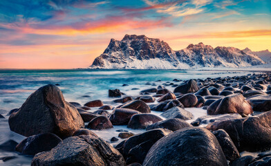 Splendid winter sunrise on Haukland Beach, Vastvagoy. Perfect morning scene of Lofoten Island, Norway, Europe. Unbelievable seascape of Norwegian sea. Beauty of nature concept background..