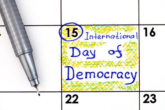 Reminder International Day of Democracy in calendar with pen