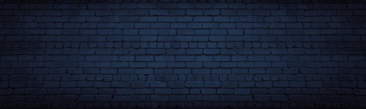 Navy blue brick wall wide texture. Dark indigo masonry large long background. Gloomy night backdrop