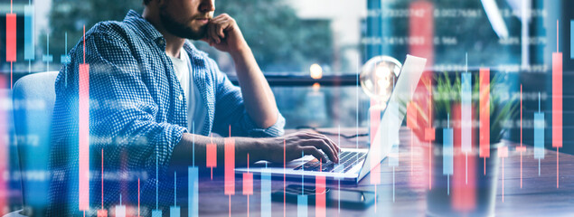 Businessman working at modern office.Technical price graph and indicator, red and green candlestick chart and stock trading computer screen background. Double exposure. Trader analyzing data